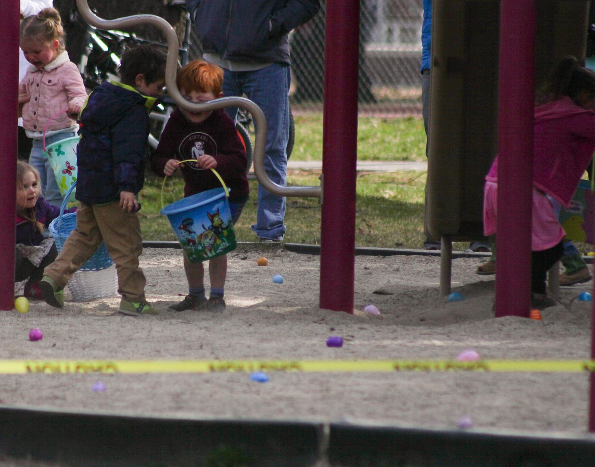 A child bonks his head after leaning down to pick up an egg at Saturday's Easter egg hunt.
