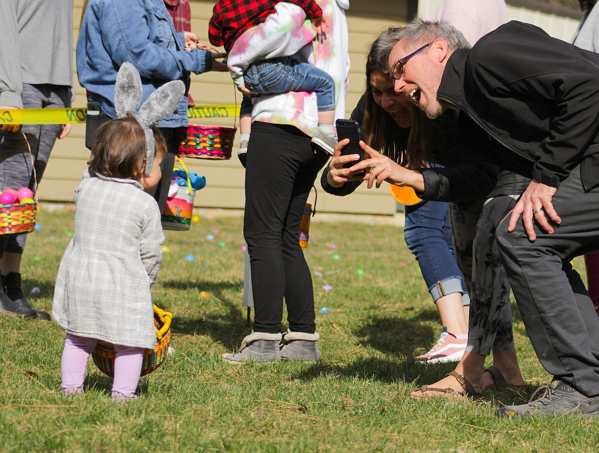 Family members take photos of a girl Saturday at Lakeview Park.