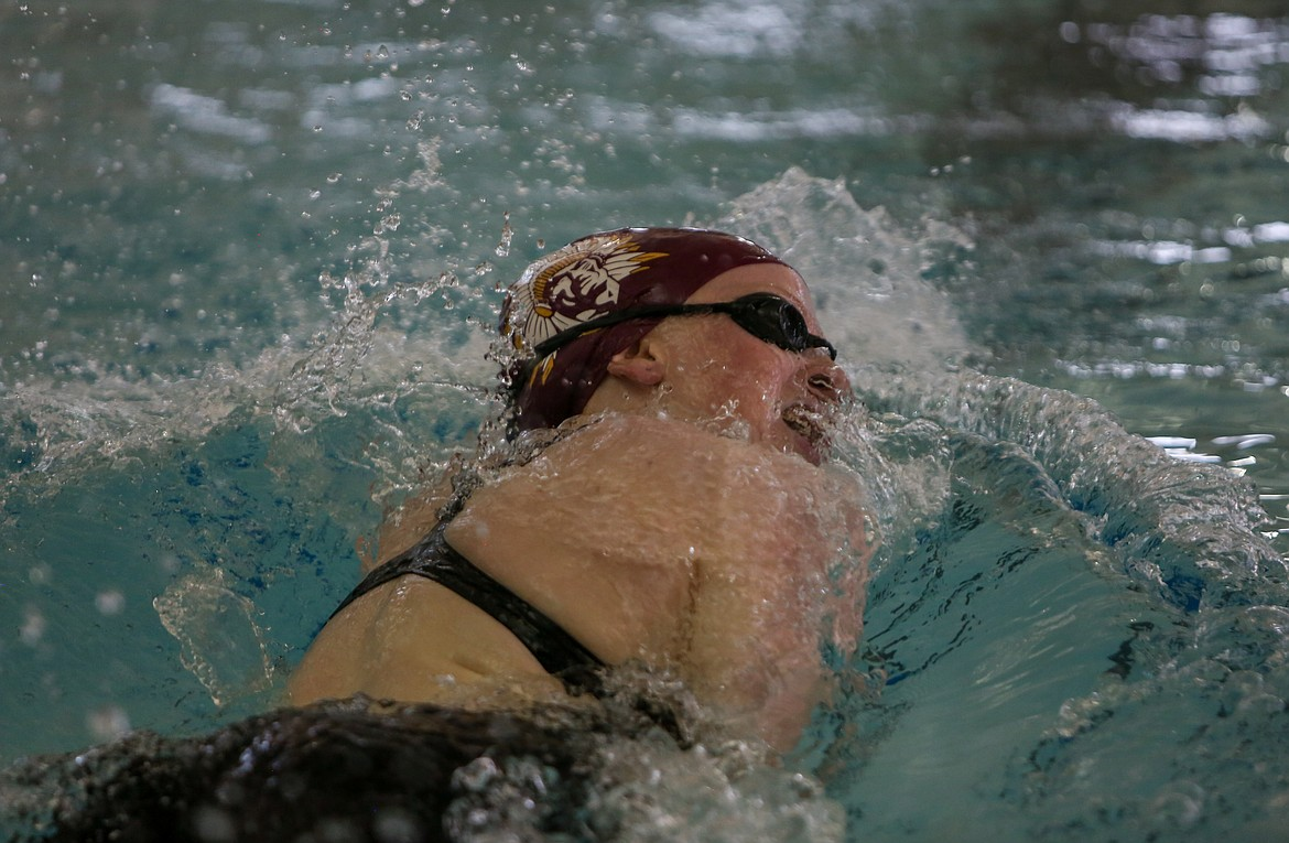 Moses Lake's Laurel Knox makes her way back down the pool at Moses Lake High School during the 500-yard freestyle event on Thursday afternoon.
