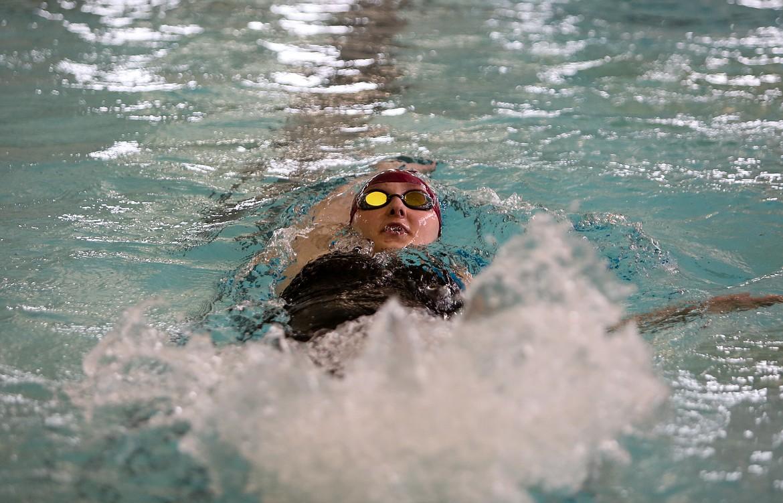 Moses Lake's Aniston Dana backstrokes across Tony St. Onge Pool of Dreams last Thursday during the 200-yard individual medley event.