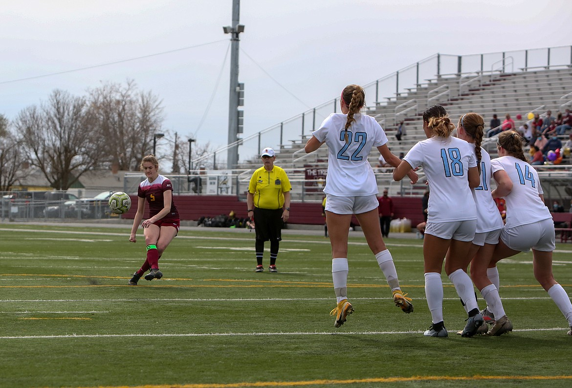 Senior Olivia Waites takes a free kick for Moses Lake on Saturday afternoon against Eastmont at Lions Field.
