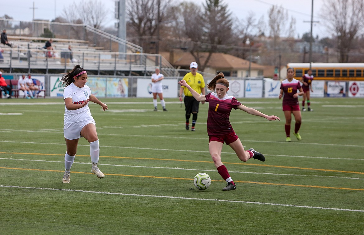 Kaydence Martinez fires in a goal in the first half to give Moses Lake an early lead against Eastmont in the season finale on Saturday at Lions Field.