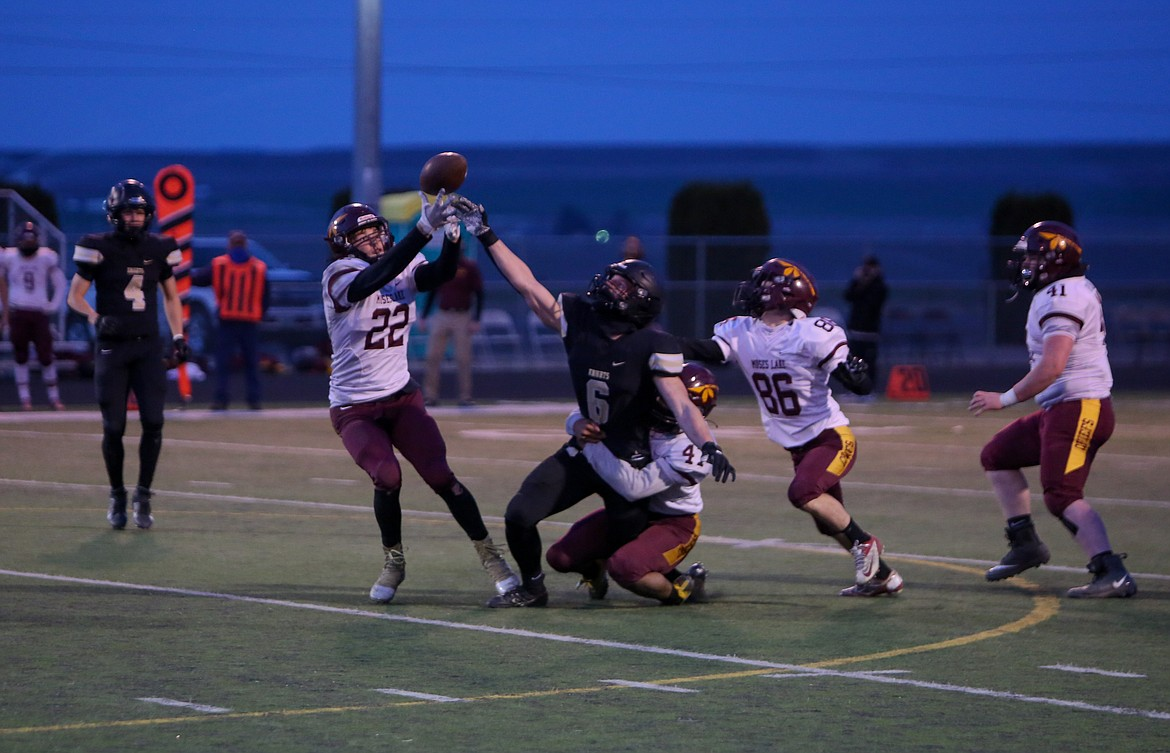 Moses Lake's Jackson Purcell takes advantage of a bobbled catch to pull in the first of two interceptions in the second quarter against Royal on Friday night.