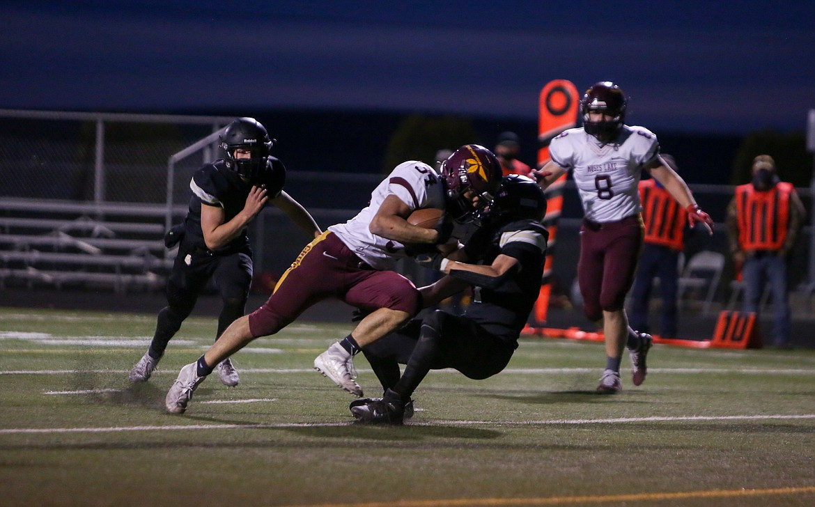 Moses Lake's Gerardo Nova powers his way in for a rushing touchdown late in the first half against Royal on Friday night in Royal City.