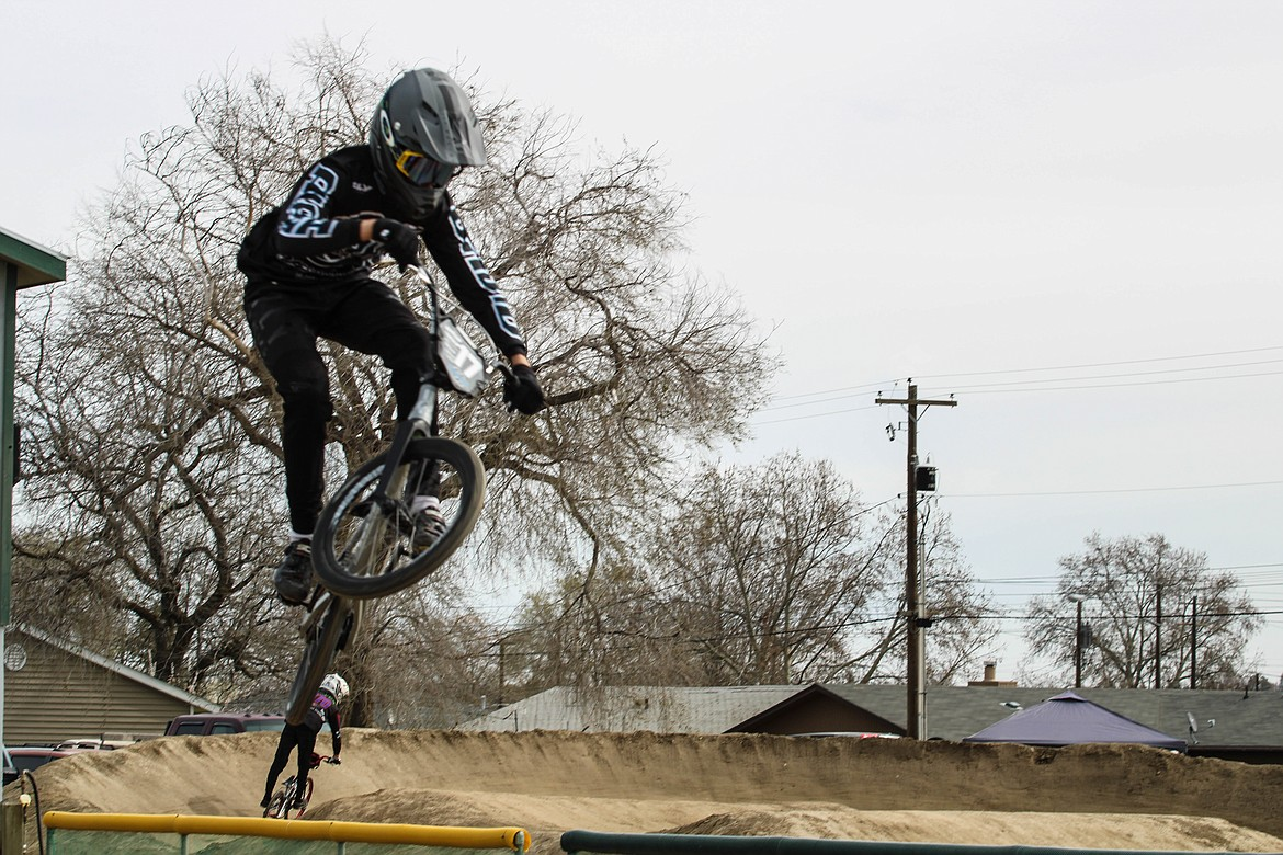 Newman Lake resident and expert rider Tarin Fields, age 13 and ranked 17th nationally, takes a test ride before Saturday's race in Moses Lake.