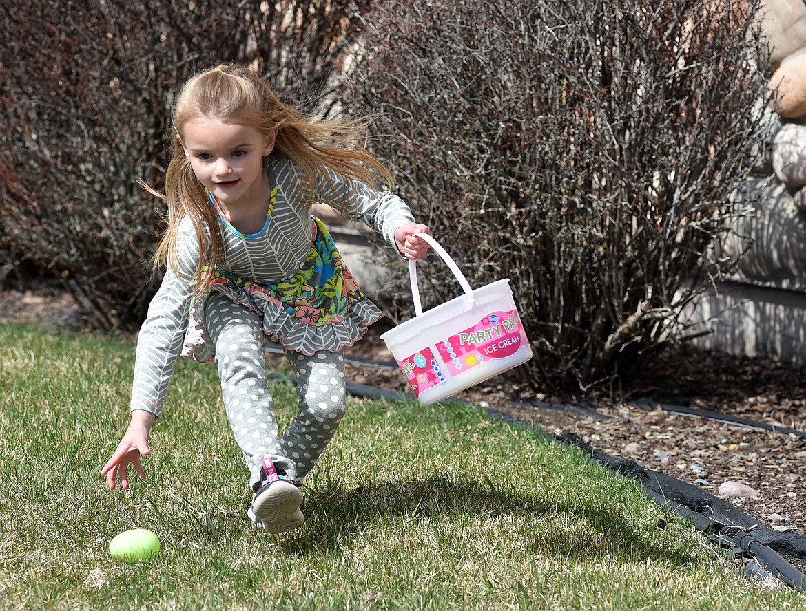 Ashton Walter, 5, snatches up an egg Saturday during an Easter egg hunt hosted by The Springs at Whitefish. (Heidi Desch/Whitefish Pilot)