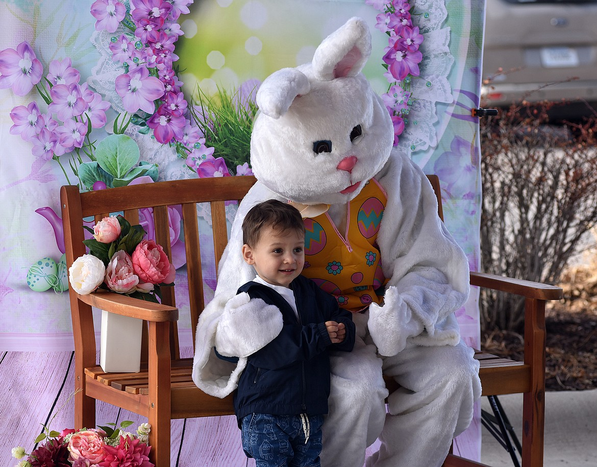 Paxton Moore, 2, poses for a photo with the Easter Bunny during an Easter party Saturday hosted by The Springs at Whitefish. (Heidi Desch/Whitefish Pilot)