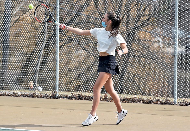 Lady Bulldog Alivia Lusko hits a shot during the high school girls tennis practice on Thursday. (Whitney England/Whitefish Pilot)