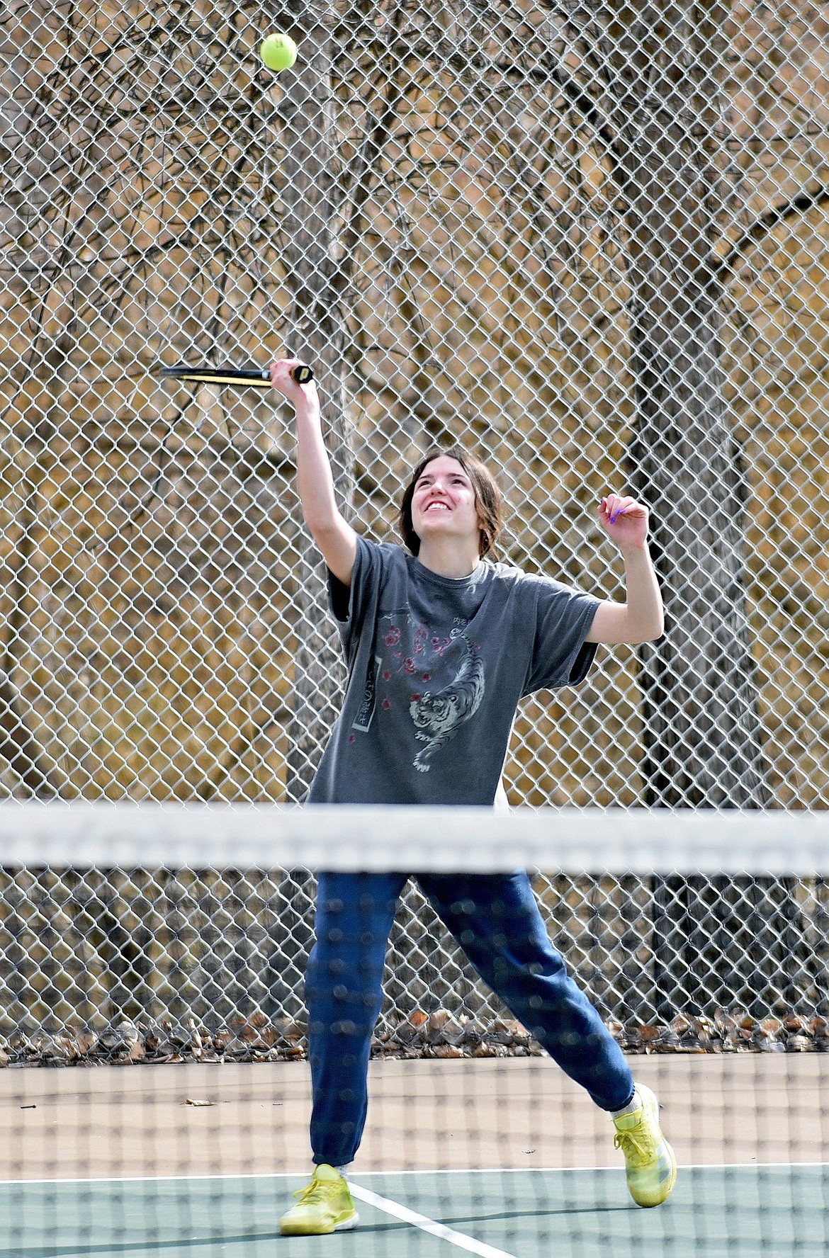 Whitefish's Ashley Gunset hits a ball during a drill at a high school girls tennis practice on Thursday. (Whitney England/Whitefish Pilot)
