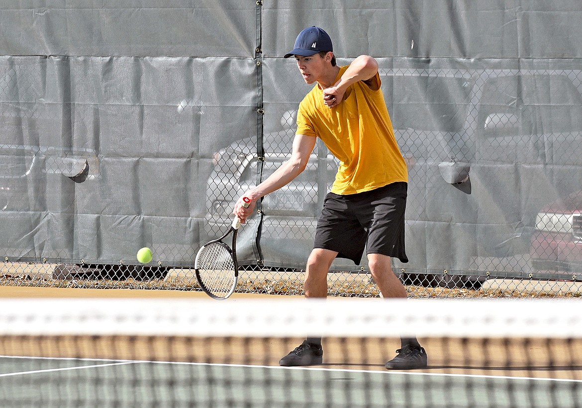 Bulldog Jack Robertson lines up a shot during the boys high school tennis practice on Thursday. (Whitney England/Whitefish Pilot)