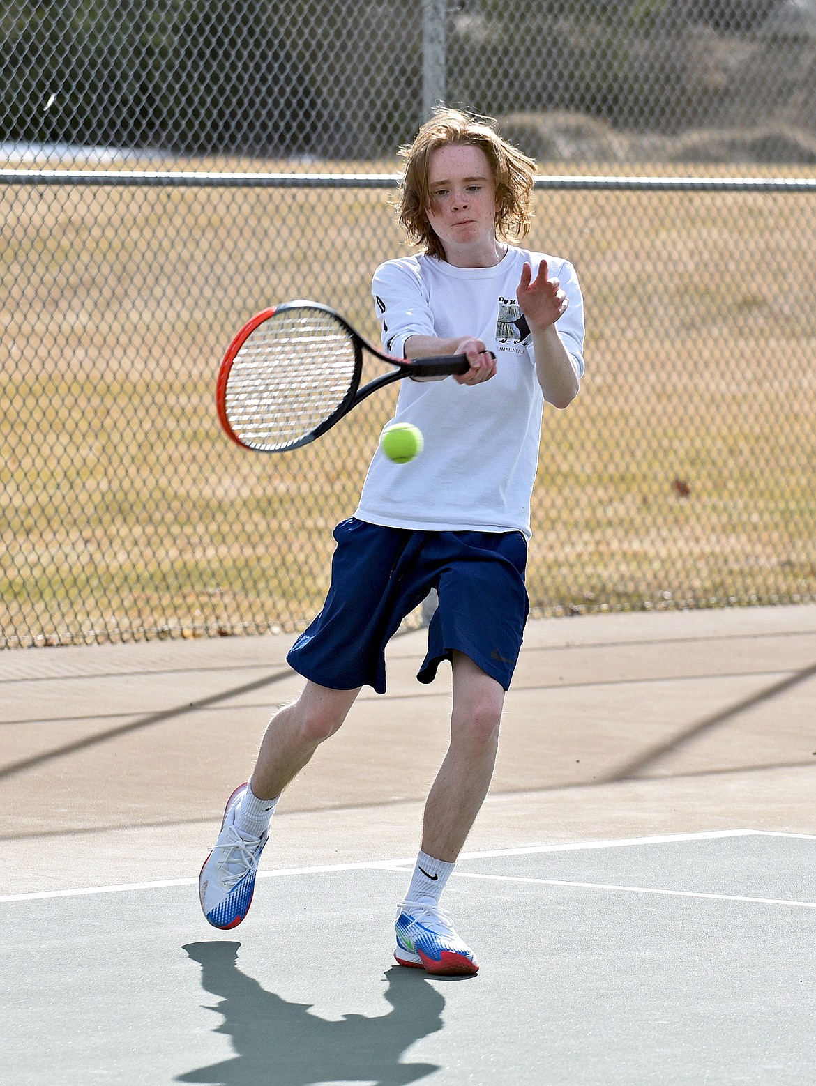 Whitefish's Connor Kelly plays against his teammates during the boys high school tennis practice on Thursday. (Whitney England/Whitefish Pilot)
