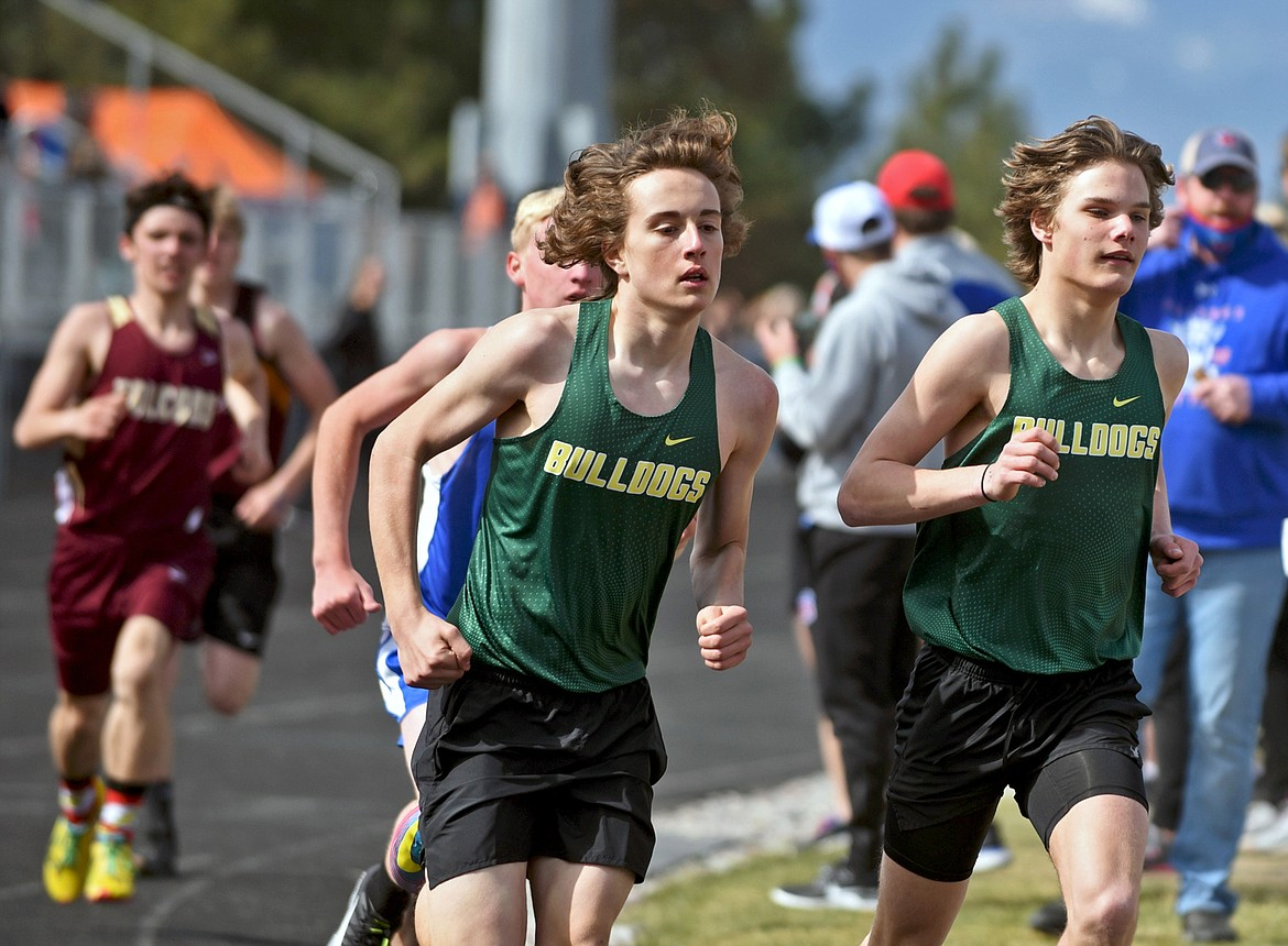 Whitefish's Deneb Linton and Mason Genovese run in the 1600 meter race at the Bigfork Invite track meet in Bigfork on Saturday. (Scott Shindledecker/Daily Inter Lake)