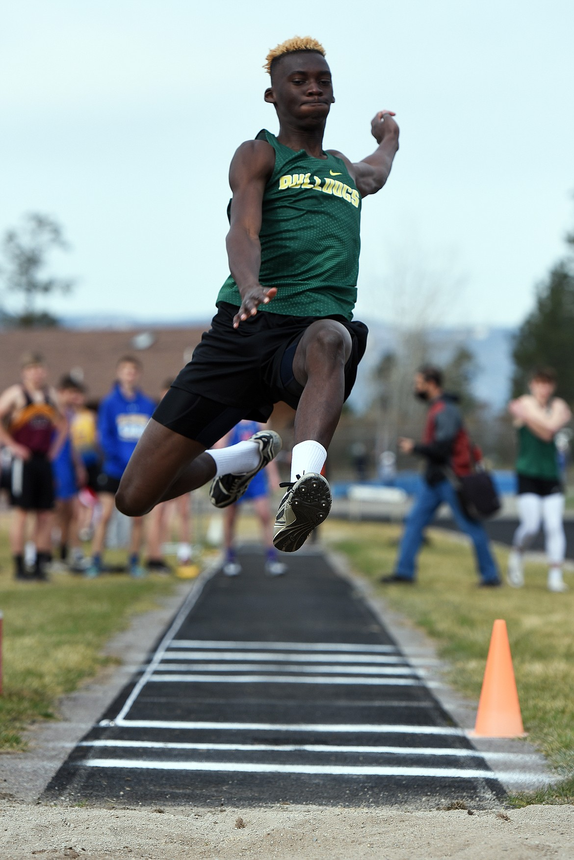 Bulldog Marvin Kimera flies to a fourth-place finish in the long jump at the Bigfork Invite track meet in Bigfork on Saturday. (Jeremy Weber/Daily Inter Lake)