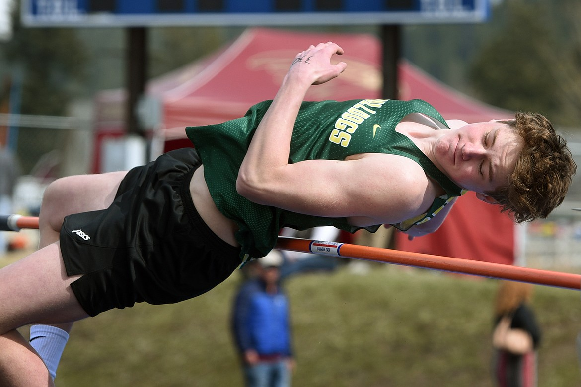 Bulldog Jack Sears clears the bar in the high jump event at the Bigfork Invite in Bigfork on Saturday. (Jeremy Weber/Daily Inter Lake)