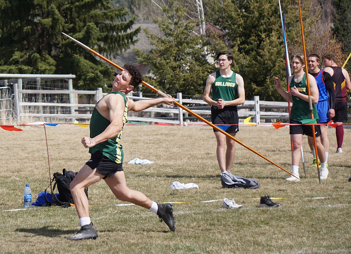 Whitefish junior Dennis Shestak throws the javelin during the Bigfork Invite Saturday. (Matt Weller photo)