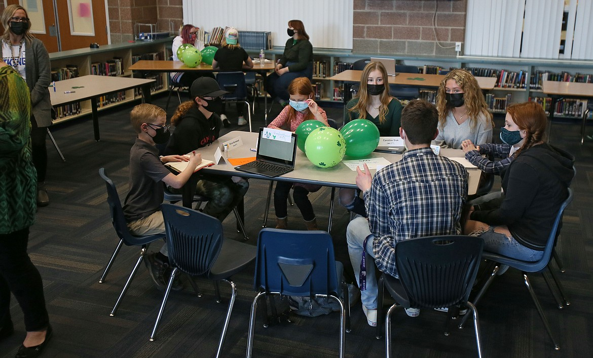 Students wear face masks during the first in-person meeting of the Student Advisory Group in March. Masks were a hot topic Monday during the Coeur d'Alene School Board meeting.