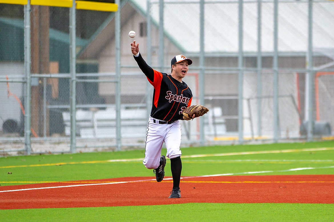 Coby Rogers makes a throw from third base last Thursday.