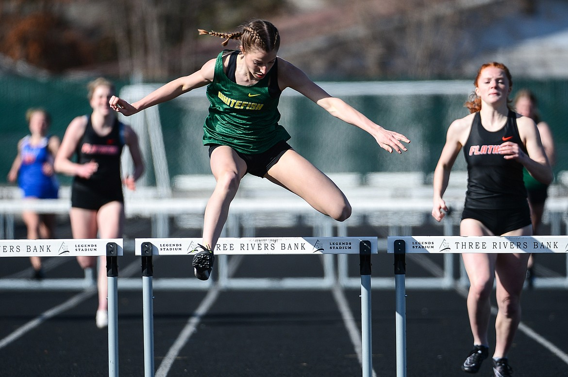 Whitefish's Hailey Ells clears the last jump in the 300 meter hurdles during a track and field meet with Bigfork and Flathead high schools at Legends Stadium on Tuesday. (Casey Kreider/Daily Inter Lake)