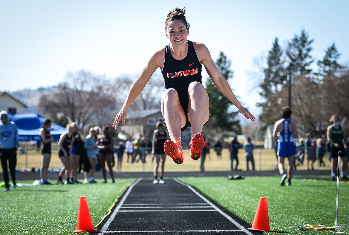 Flathead's Peyton Walker competes in the long jump during a track and field meet with Whitefish and Bigfork high schools at Legends Stadium on Tuesday. (Casey Kreider/Daily Inter Lake)