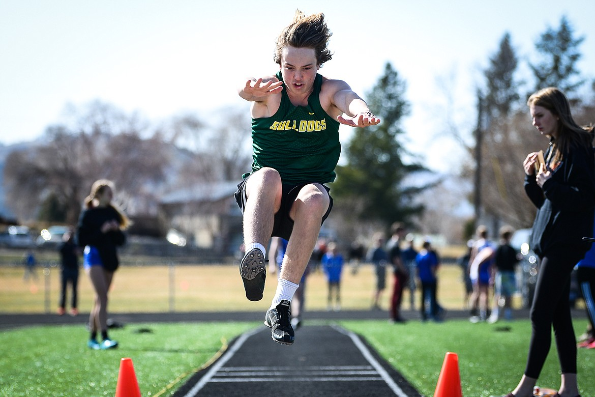 Whitefish's Ethan Schott competes in the long jump during a track and field meet with Flathead and Bigfork high schools at Legends Stadium on Tuesday. (Casey Kreider/Daily Inter Lake)