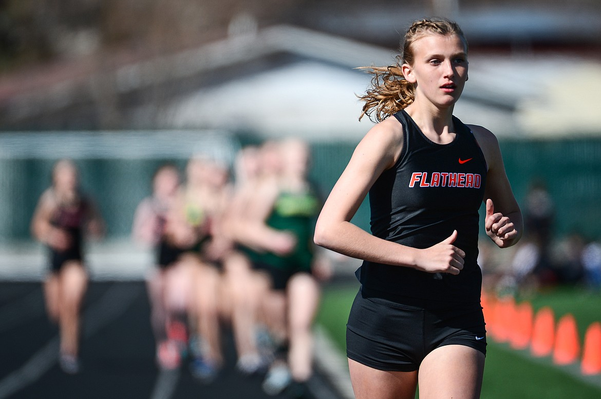 Flathead's Hannah Perrin approaches the finish line the 1600 meter run during a track and field meet with Whitefish and Bigfork high schools at Legends Stadium on Tuesday. (Casey Kreider/Daily Inter Lake)