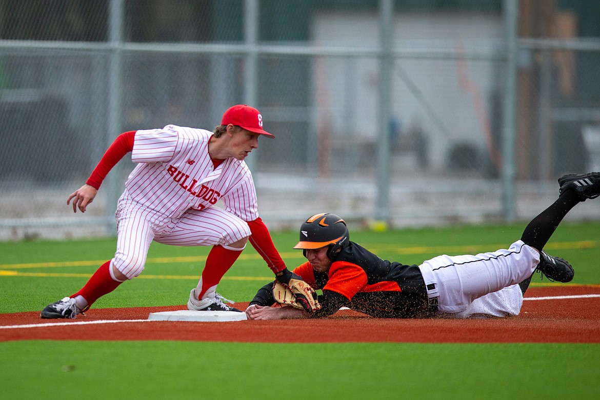 Sandpoint's Zeke Roop (left) tags Priest River's Coby Rogers before he reaches third base last Thursday.