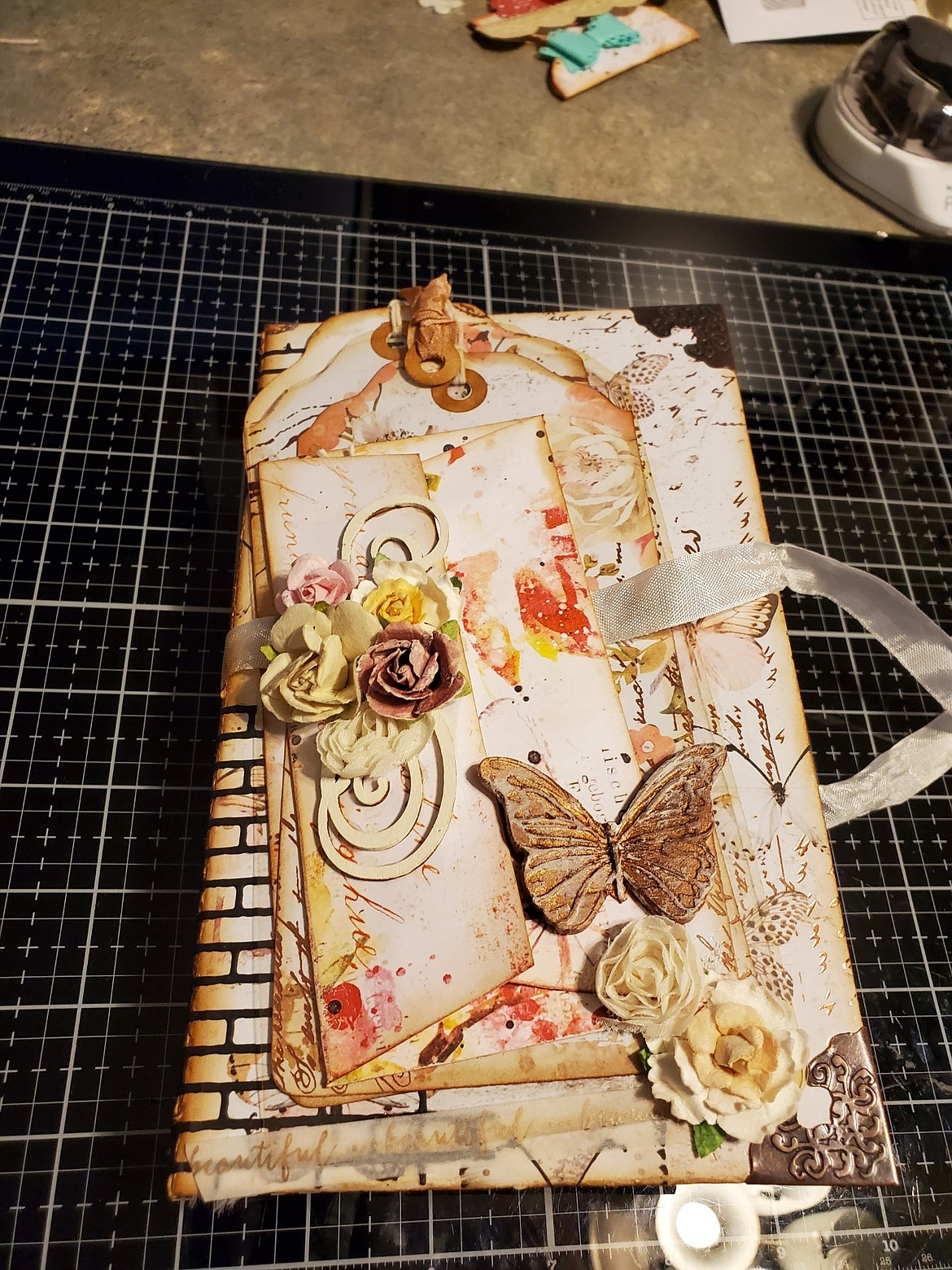A journal created by paper artist Tiffany Fultz, Old Hotel Art Gallery artist of the month for April.
