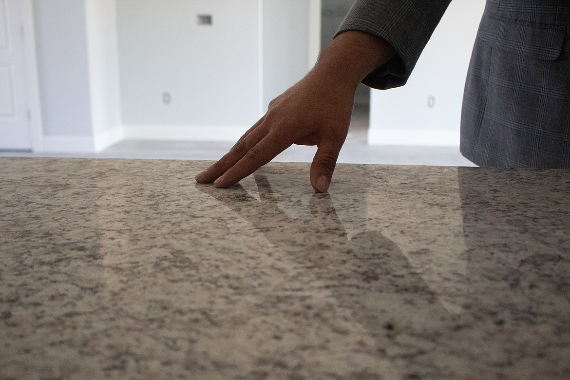 Jessie Dominguez, an Othello realtor with Imagine Realty, showcases the types of countertops going into new home builds in Othello currently.