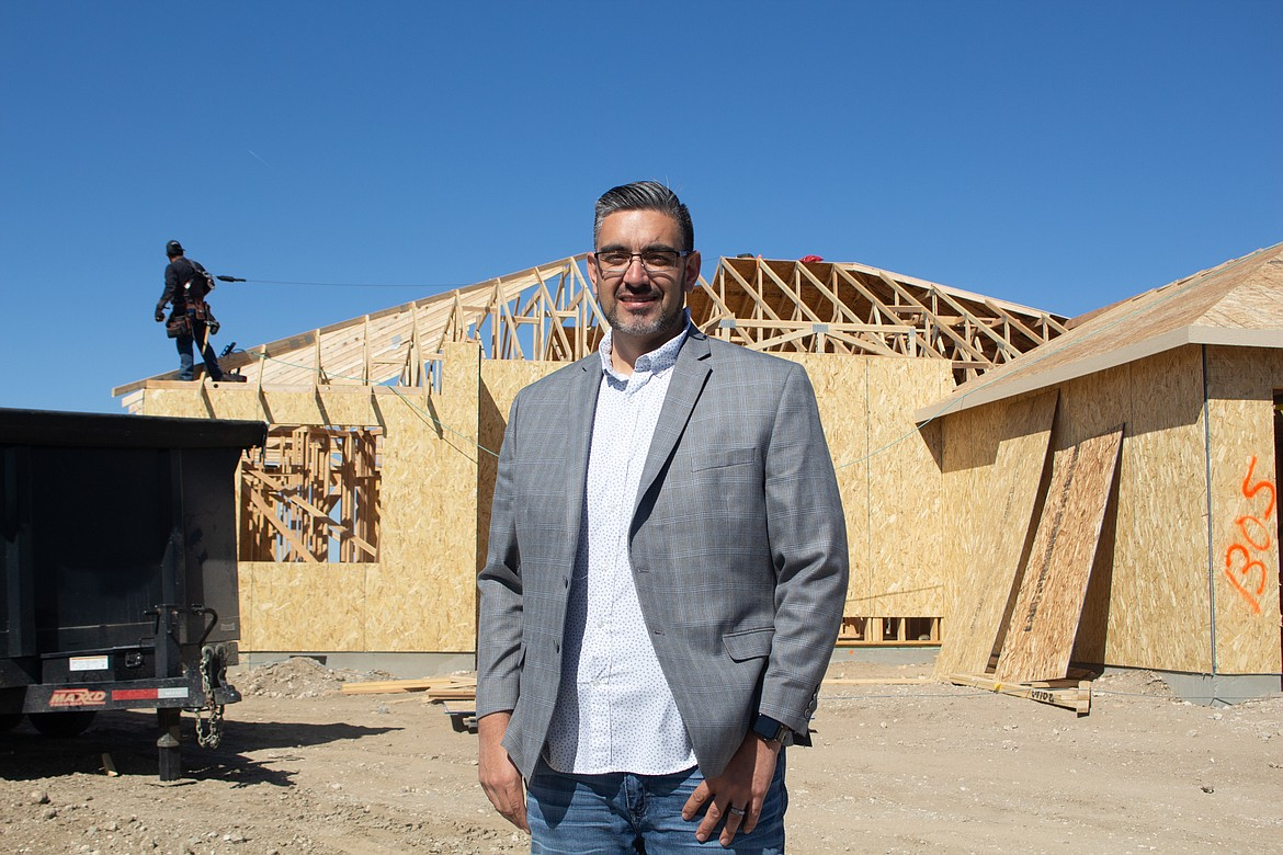 """Othello realtor Jessie """"Weno"""" Dominguez stands in front of a home currently being built in Othello on Tuesday afternoon."""