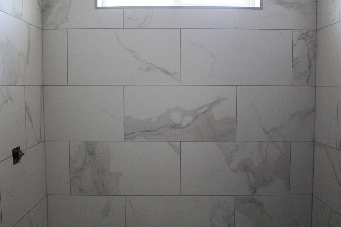 The modern tile design in walk-in showers has been a popular trend with home buyers and in new homes going up around the Columbia Basin.
