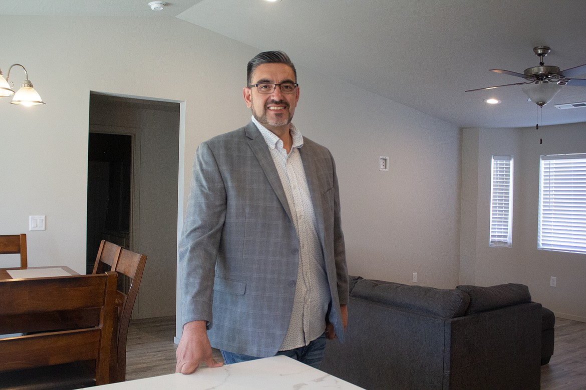 Othello realtor Jessie Dominguez stands inside one of the homes recently completed in Othello that still holds a lot of the modern, open-floor ideals buyers are looking for while giving up a few of those amenities to keep costs affordable for first-time homeowners.