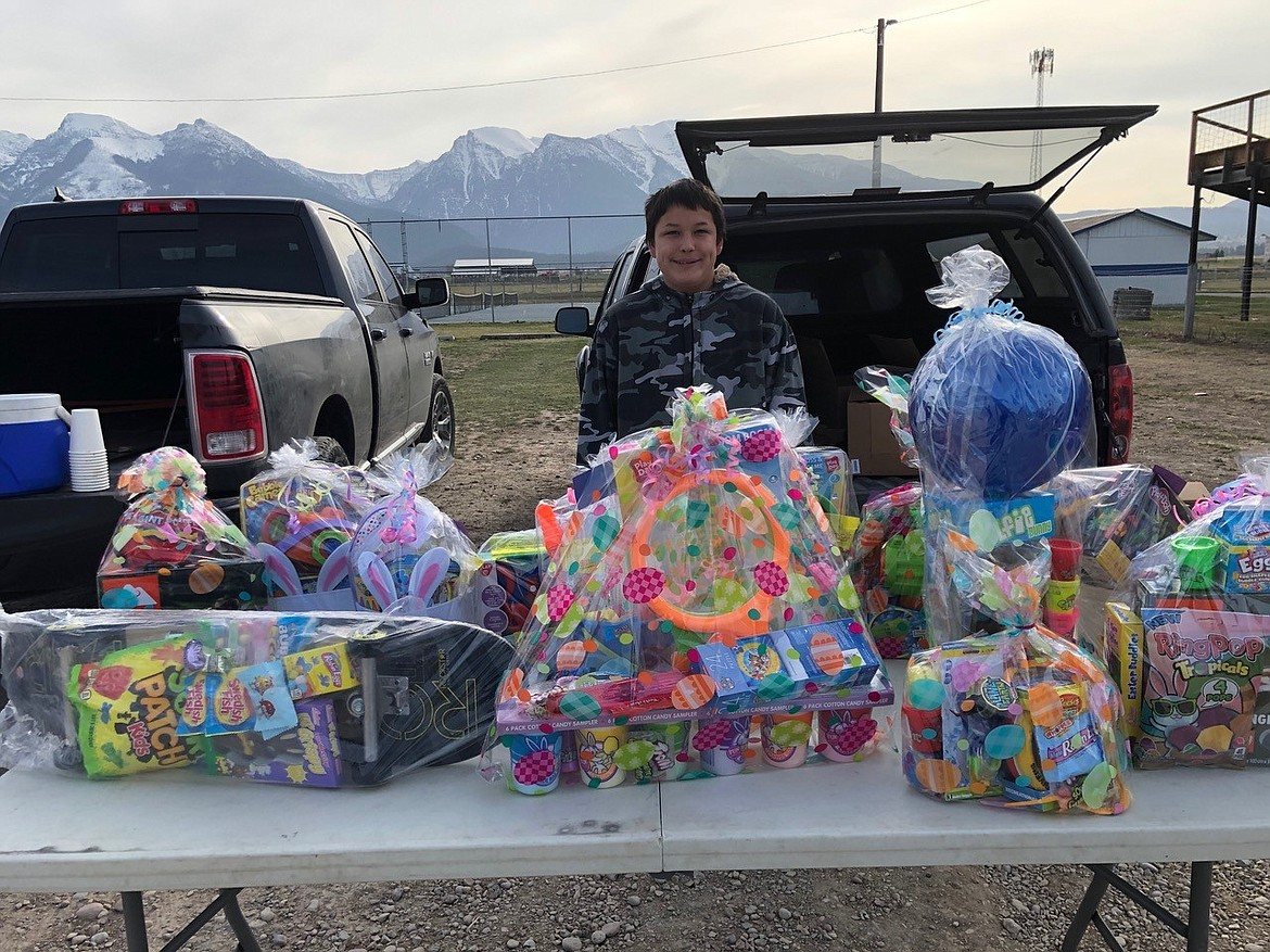 Sage Assiniboin, 12, has helped his family make the prize baskets for the St. Ignatius Easter Egg Hunt for the last eight years. (Courtesy of Irene Pritzak)