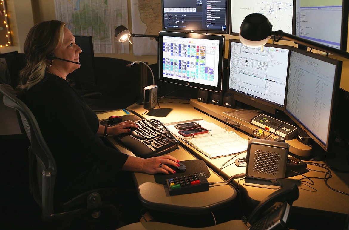 Jennifer Sullivan monitors screens and takes calls at the Idaho State Police Regional Communication Center in Coeur d'Alene on Friday.