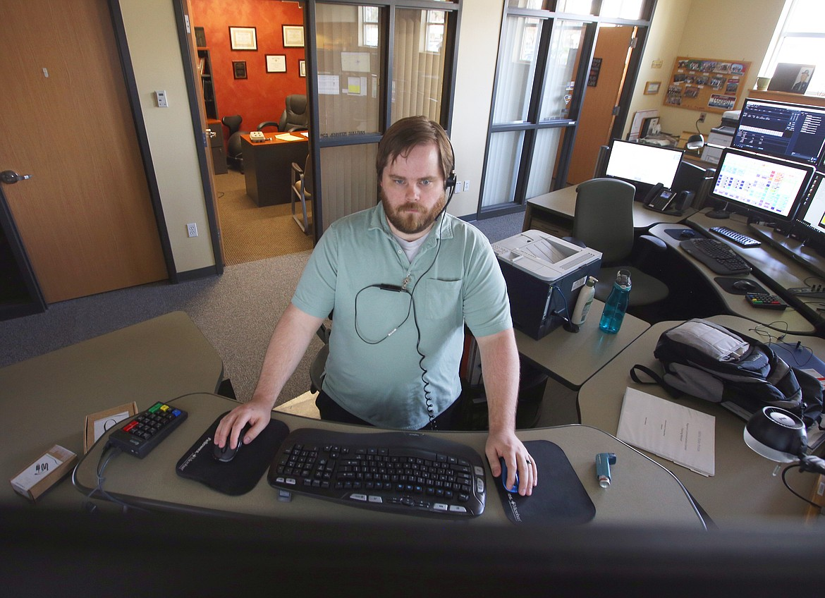 Mark Wise monitors screens and calls at the Idaho State Police Regional Communication Center in Coeur d'Alene on Friday.