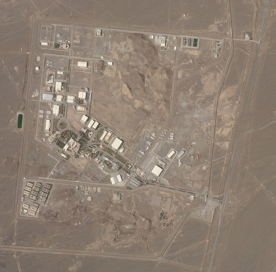 This satellite photo from Planet Labs Inc. shows Iran's Natanz nuclear facility on Wednesday, April 7, 2021. Iran's Natanz nuclear site suffered a problem Sunday, April 11, involving its electrical distribution grid just hours after starting up new advanced centrifuges that more quickly enrich uranium, state TV reported. It was the latest incident to strike one of Tehran's most-secured sites amid negotiations over the tattered atomic accord with world powers.