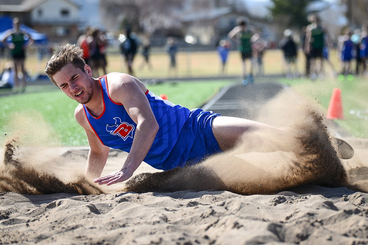 Bigfork's Cormac Benn competes in the long jump during a track and field meet with Flathead and Whitefish high schools at Legends Stadium on Tuesday. (Casey Kreider/Daily Inter Lake)