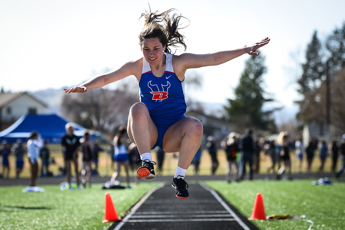Bigfork's Olivia Pendlay competes in the triple jump during a track and field meet with Flathead and Whitefish high schools at Legends Stadium on Tuesday. (Casey Kreider/Daily Inter Lake)