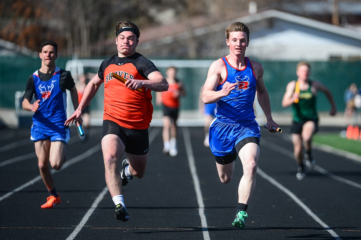 Flathead's Alec Thomas and Bigfork's Noah Kinslow approach the finish line in the 400 meter relay during a track meet with Flathead, Bigfork and Whitefish high schools at Legends Stadium on Tuesday. (Casey Kreider/Daily Inter Lake)