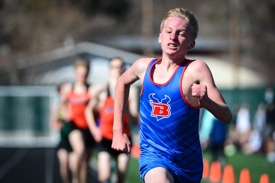 Bigfork's Jack Jensen approaches the finish line in the 1600 meter run during a track and field meet with Flathead and Whitefish high schools at Legends Stadium on Tuesday. (Casey Kreider/Daily Inter Lake)