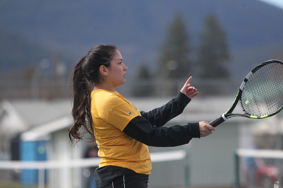Jessica Cunningham prepares to return a ball during the top doubles category against Whitefish on April 3. (Will Langhorne/The Western News)