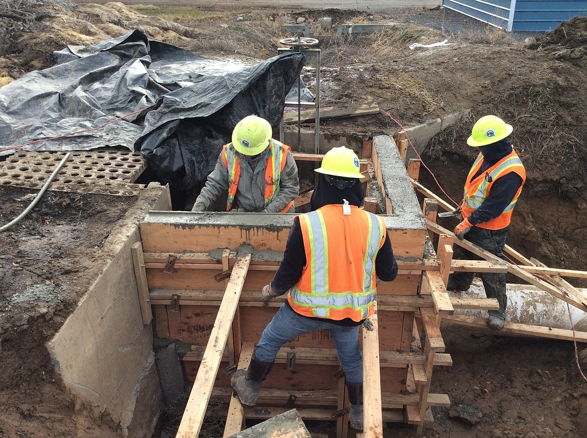 Workers with the Quincy-Columbia Basin Irrigation District prepare a segment of W26A17 pipeline, recently installed to a replace an open-air irrigation ditch.
