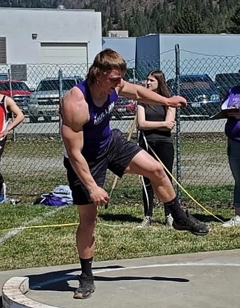 Mullan junior Luke Trogden throws the shot during Saturday's Track and Field event in Kellogg. Trogden took first place in the event.