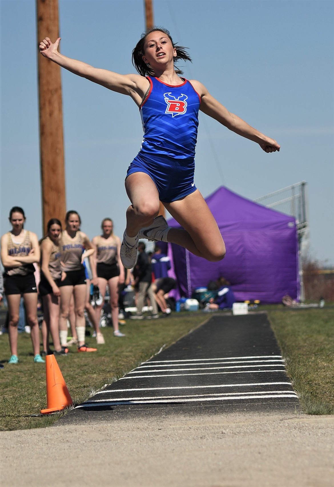 Audrey Buenz set a new personal best of 14 feet, 6 inches in Ronan Saturday as she finished third in the long jump at the Dilly Bar Invitational. (Scot Heisel for the Eagle)