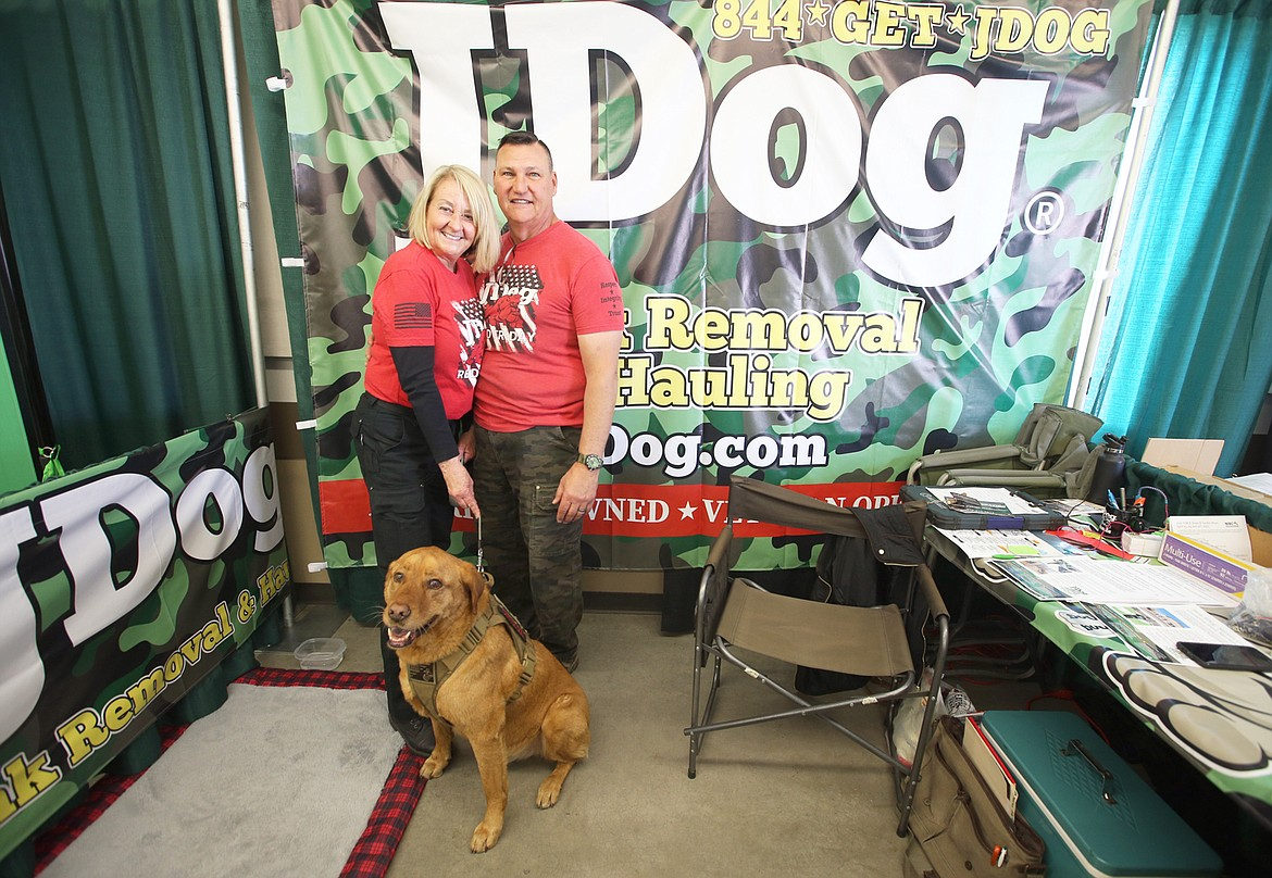 John and Regina Merwald were joined by their 12-year-old dog Comet at their JDog Junk Removal and Hauling booth during the Home and Garden Show on Friday.