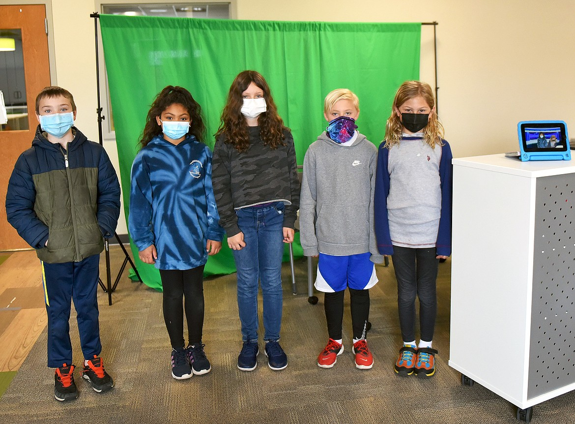 A group of students at Muldown gathers every school day at 2:30 p.m. to record the Muldown News for the following day. The student-led program launched last month at the elementary school. From left to right, Hudson Clark, Audrey Jones, Gianna Mitchell, Kaleb Stevens and Elijah Walrath. (Whitney England/Whitefish Pilot)