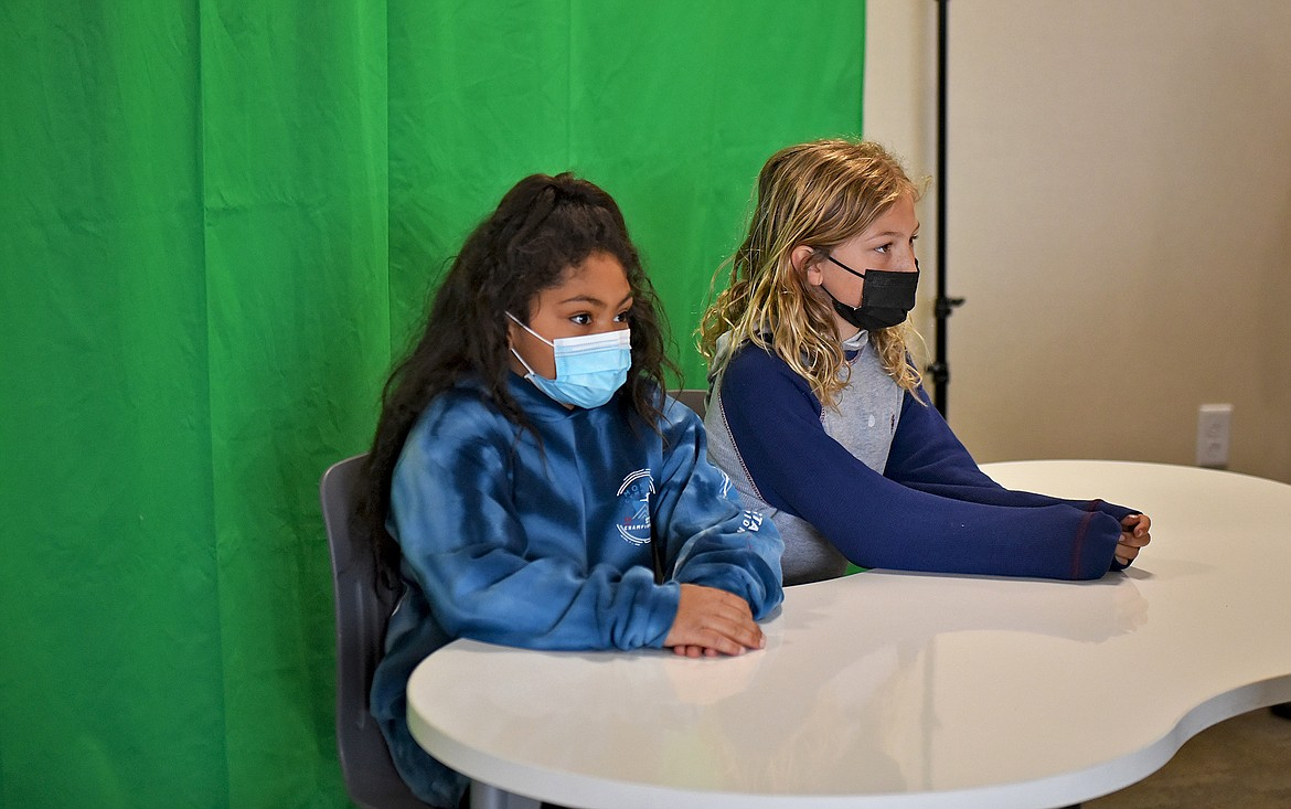Muldown News anchors Audrey Jones and Elijah Walrath deliver the news of the day which is recorded via tablet and then uploaded to the school website to be shown in every classroom the following morning. (Whitney England/Whitefish Pilot)