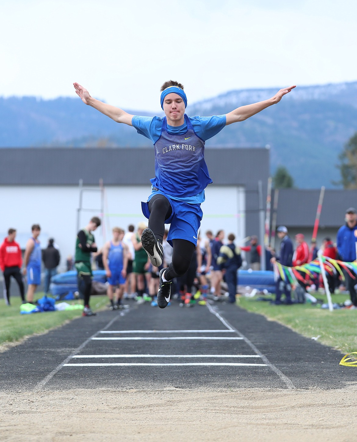 Carson Yetter takes off in the long jump on Saturday.