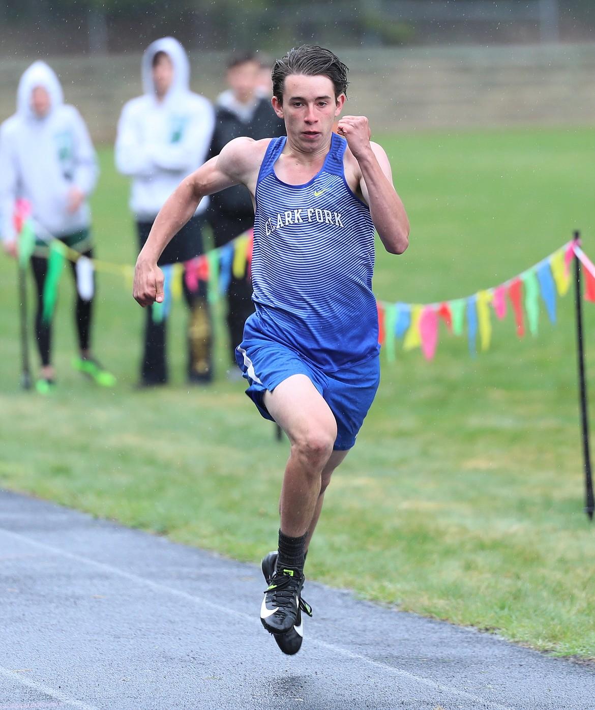 Joe Bopp runs the 200 on Saturday.