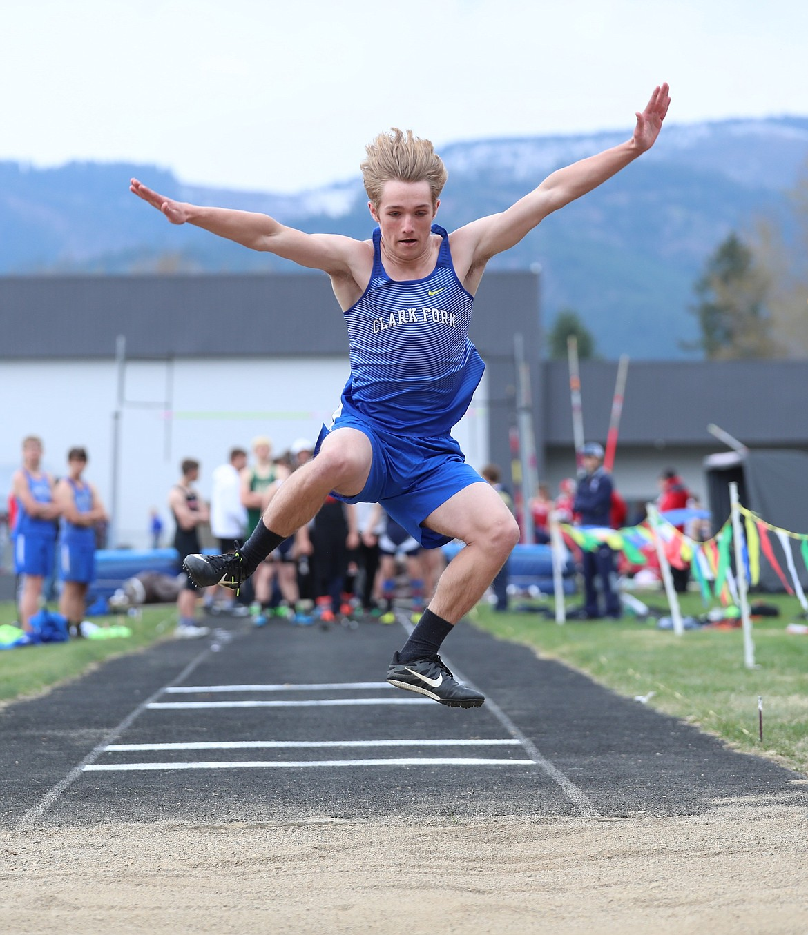 Wyatt Mintken prepares to land in the pit in the long jump on Saturday.