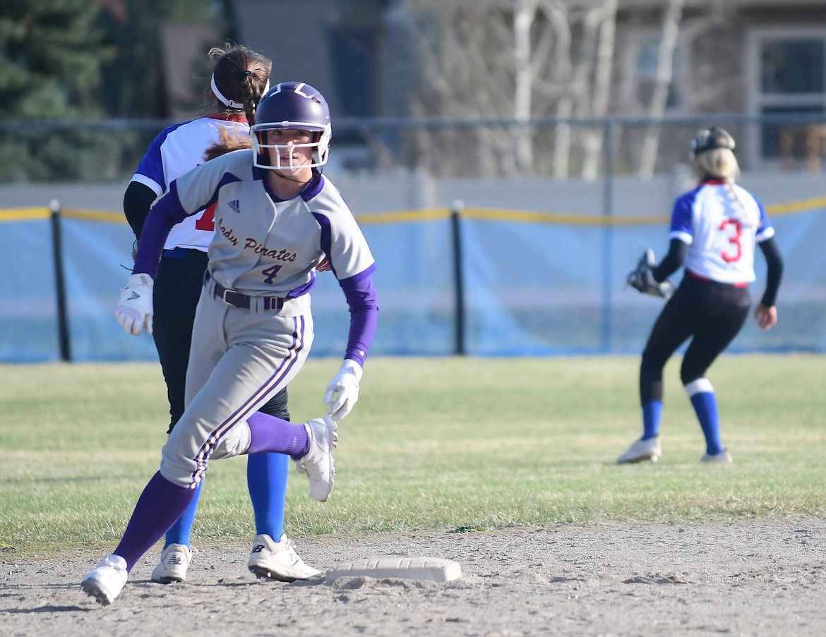 Kobbey Smith rounds second base against Columbia Falls. (Teresa Byrd/Hungry Horse News)